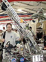 Eric with the robot at Epcot Center, April 2001